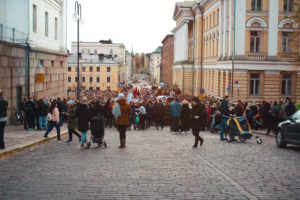 People getting ready before the march. The photo was taken with solar powered camera. Photo: Tiina Junno